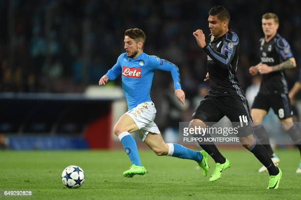 Napoli's forward from Belgium Dries Mertens vies with Real Madrid's Brazilian midfielder Casemiro during the UEFA Champions League football match SSC...