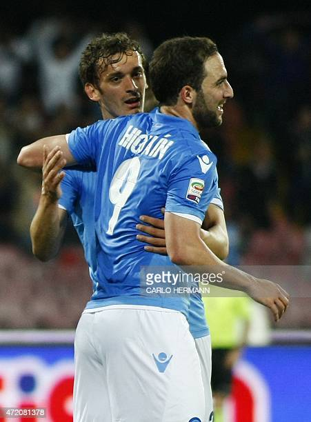 Napoli's forward from Italy Manolo Gabbiadini celebrates with teammate Napoli's forward from Argntina and France Gonzalo Higuain after scoring during...