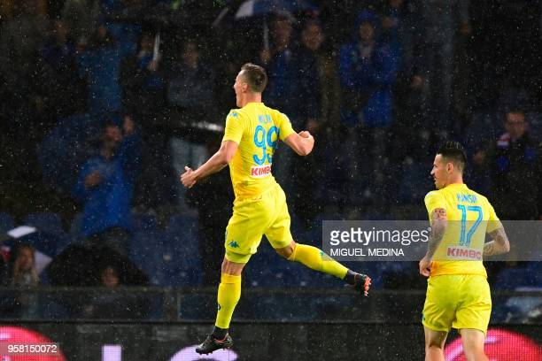 Napoli's forward from Poland Arkadiusz Milik celebrates after scoring during the Italian Serie A football match Sampdoria vs Napoli on May 13 2018 at...