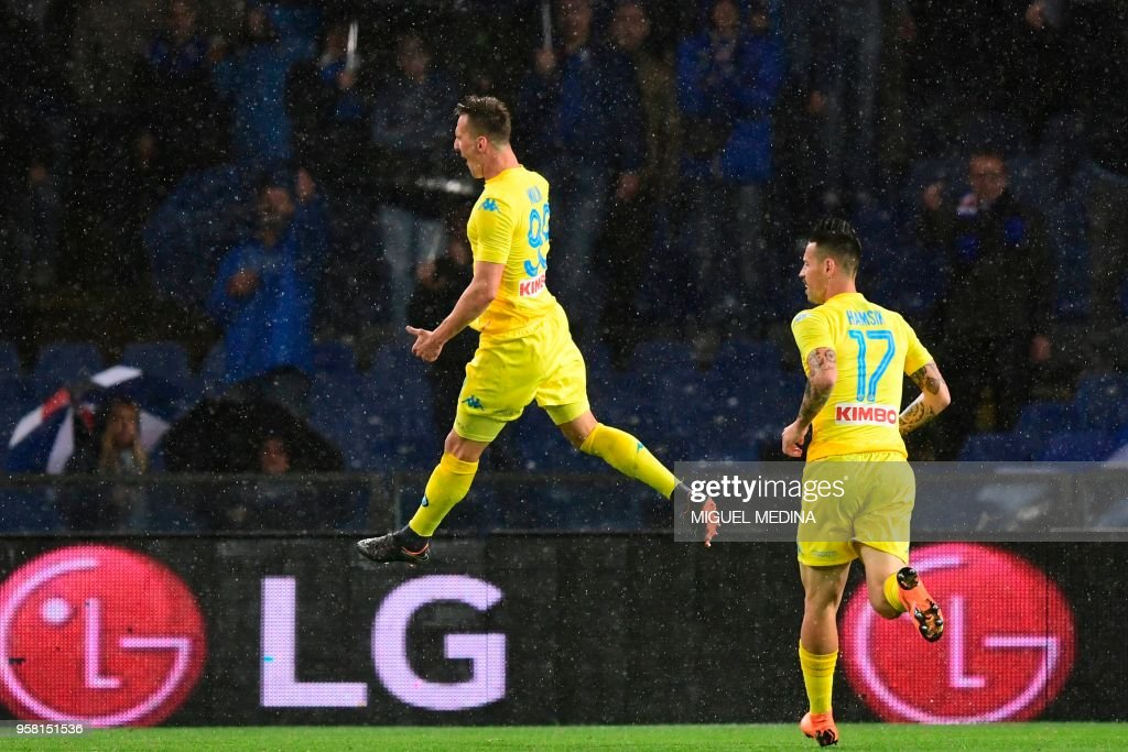 Napoli's forward from Poland Arkadiusz Milik (L) celebrates after scoring during the Italian Serie A football match Sampdoria vs Napoli on May 13, 2018 at the Luigi Ferraris stadium in Genova. (Photo by Miguel MEDINA / AFP) / The erroneous mention[s] appearing in the metadata of this photo by Miguel MEDINA has been modified in AFP systems in the following manner: [May 13] instead of [April 13]. Please immediately remove the erroneous mention[s] from all your online services and delete it (them) from your servers. If you have been authorized by AFP to distribute it (them) to third parties, please ensure that the same actions are carried out by them. Failure to promptly comply with these instructions will entail liability on your part for any continued or post notification usage. Therefore we thank you very much for all your attention and prompt action. We are sorry for the inconvenience this notification may cause and remain at your disposal for any further information you may require.