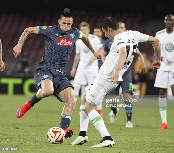Napoli's forward from Slovakia Marek Hamsik fights for the ball with Wolfsburg's midfielder from Germany Christian Trasch during the UEFA Europa...