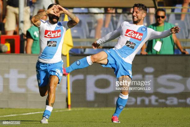 Napoli's forward Lorenzo Insigne celebrates after scoring with teammate Napoli's forward Dries Mertens from Belgium during the Italian Serie A...