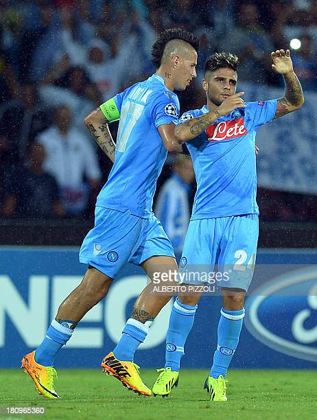 Napoli's forward Lorenzo Insigne celebrates with teammate Napoli's midfielder Marek Hamsik of Slovakia after scoring during the group F Champions...
