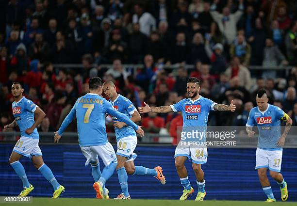 Napoli's forward Lorenzo Insigne celebrates with teammates after scoring during the Italian Tim Cup final football match between Fiorentina and...
