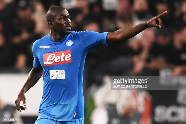 Napoli's French defender Kalidou Koulibaly celebrates after scoring a goal during the Italian Serie A football match between Juventus and Napoli on...