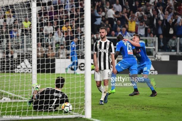 Napoli's French defender Kalidou Koulibaly celebrates with Napoli's Polish striker Arkadiusz Milik after scoring a goal during the Italian Serie A...