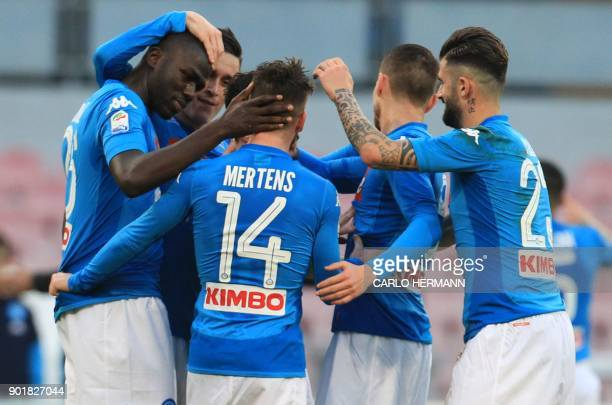 Napoli's French defender Kalidou Koulibaly celebrates with teammates after scoring during the Italian Serie A football match SSC Napoli vs Hellas...