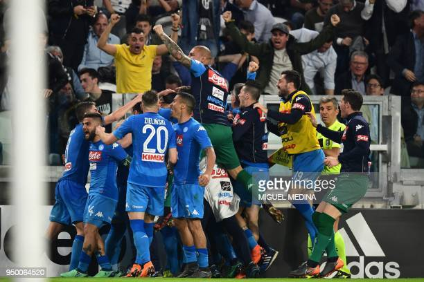 Napoli's French defender Kalidou Koulibaly celebrates with teammates after scoring a goal during the Italian Serie A football match between Juventus...