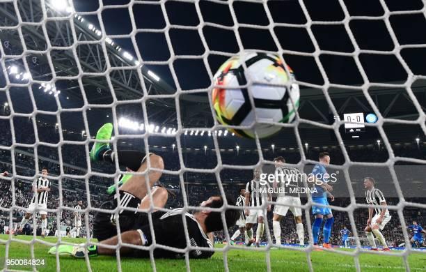 Napoli's French defender Kalidou Koulibaly scores a goal past Juventus' Italian goalkeeper Gianluigi Buffon during the Italian Serie A football match...