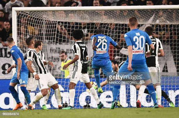 Napoli's French defender Kalidou Koulibaly scores a goal past Juventus' Italian goalkeeper Gianluigi Buffon during the Italian Serie A football match...