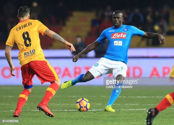 Napoli's French defender Kalidou Koulibaly vies for the ball with Benevento's Italian midfielder Danilo Cataldi during the Italian Serie A football...
