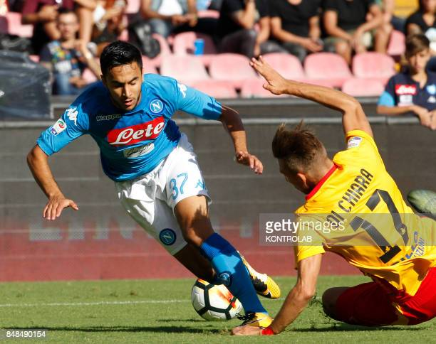 Napoli's French forward Adam Ounas fights for the ball with Benevento's Italian defender Gianluca Di Chiara during the Italian Serie A football match...