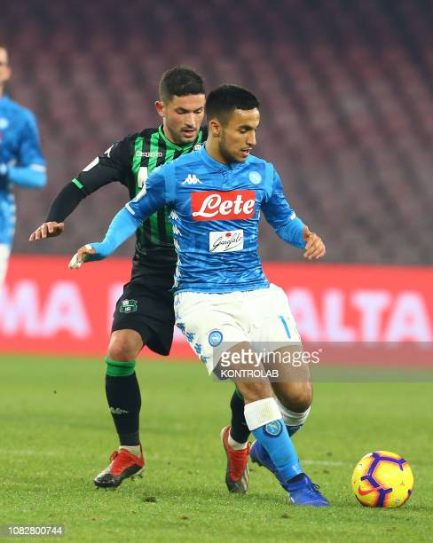 STADIUM NAPLES CAMPANIA ITALY Napoli's French forward Adam Ounas fights for the ball with Sassuolo's Italian midfielder Stefano Sensi during the...
