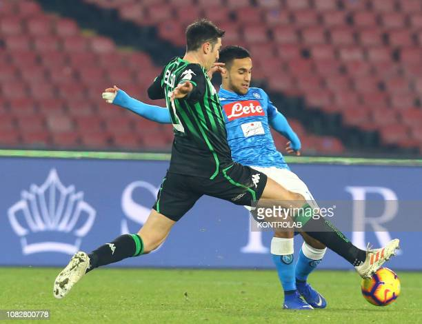 STADIUM NAPLES CAMPANIA ITALY Napoli's French forward Adam Ounas fights for the ball with Sassuolo's Italian defender Federico Peluso during the...