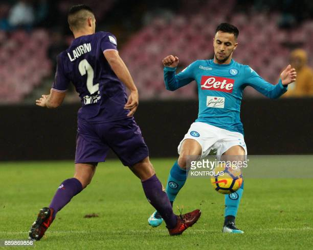 STADIUM NAPLES CAMPANIA ITALY Napoli's French striker Adam Ounas fights for the ball with Fiorentina's French defender Vincent Laurini during the...
