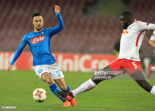 STADIUM NAPLES CAMPANIA ITALY Napoli's French striker Adam Ounas fights for the ball with Leipzig's French defender Dayot Upamecano during the UEFA...
