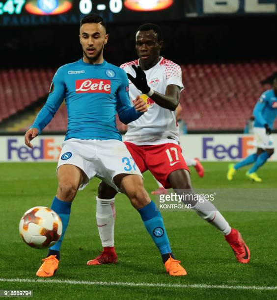 STADIUM NAPLES CAMPANIA ITALY Napoli's French striker Adam Ounas fights for the ball with Leipzig's Portuguese striker Bruma during the UEFA Europa...