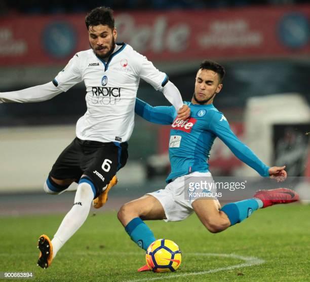 STADIUM NAPLES CAMPANIA ITALY Napoli's French striker Adam Ounas kicks the ball as fighting with Atalanta'a Argentinian defender Jose Luis Palomino...