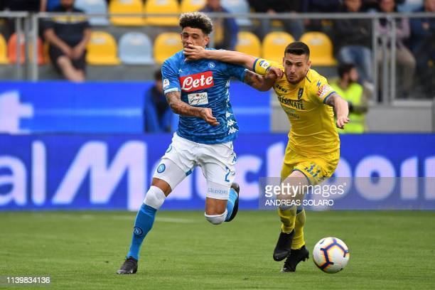 Napoli's FrenchMoroccan defender Kevin Malcuit fights for the ball with Frosinone's Italian midfielder Andrea Beghetto during the Italian Serie A...
