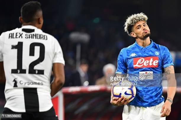 Napoli's FrenchMoroccan defender Kevin Malcuit looks at Juventus' Brazilian defender Alex Sandro during the Italian Serie A football match between...