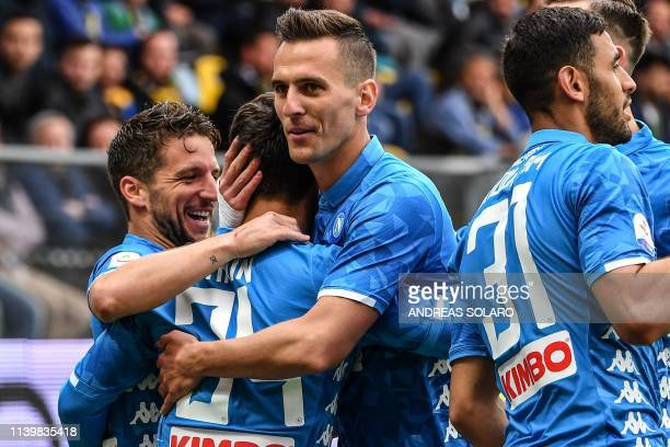 Napoli's German forward Amin Younes celebrates with his team mates after scoring a goal during the Italian Serie A football match Frosinone vs Napoli...