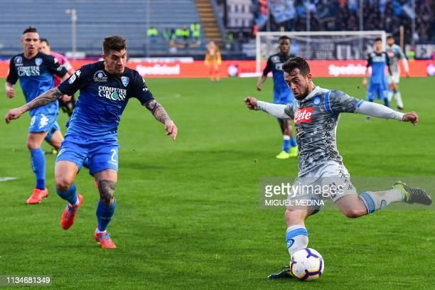 Napoli's German forward Amin Younes centres the ball past Empoli's Italian defender Giovanni Di Lorenzo during the Italian Serie A football match...