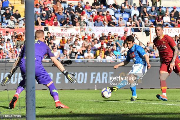 Napoli's German forward Amin Younes shoots a first time on goal before shooting again and scoring during the Italian Serie A football match AS Roma...