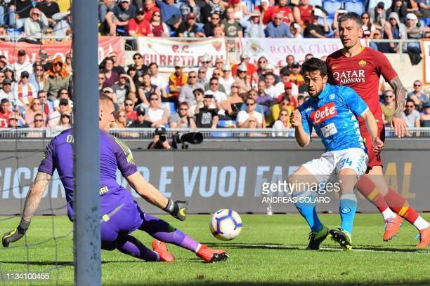 Napoli's German forward Amin Younes shoots a first time on goal before shooting again and scoring past AS Roma Swedish goalkeeper Robin Olsen despite...