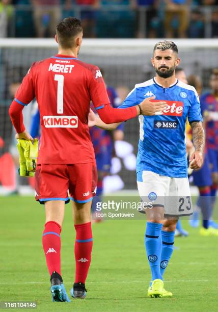Napoli's goalkeeper Alex Meret slaps hands with Napoli's Elseid Hysaj after the International Champions Cup LaLigaSerie A Cup International friendly...
