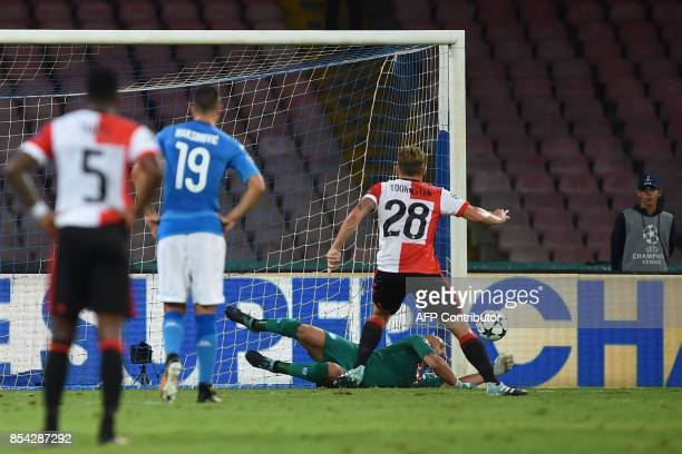 Napoli's goalkeeper from Spain Pepe Reina dives to save a penalty kick by Feyenoord's Dutch midfielder Jens Toornstra during the UEFA Champion's...