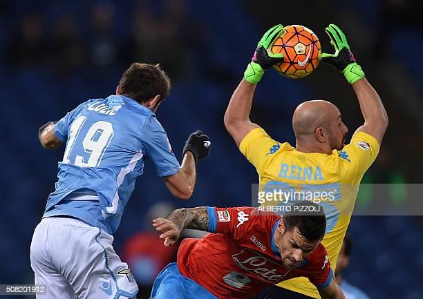 Napoli's goalkeeper from Spain Pepe Reina grabs the ball over Lazio's midfielder from BosniaHerzegovina Senad Lulic during the Italian Serie A...