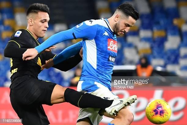 Napoli's Greek defender Konstantinos Manolas holds off Inter Milan's Argentinian forward Lautaro Martinez during the Italian Serie A football match...