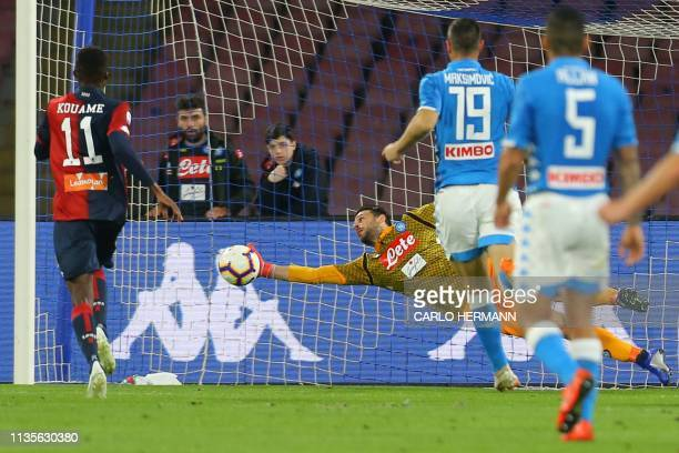 Napoli's Greek goalkeeper Orestis Karnezis deflects a shot by Genoa's Macedonian forward Goran Pandev during the Italian Serie A football match...