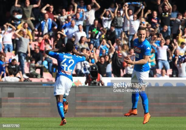 Napoli's Guinean midfielder Amadou Diawara celebrates after scoring a goal next to Napoli's Polish midfielder Piotr Zielinski during the Italian...