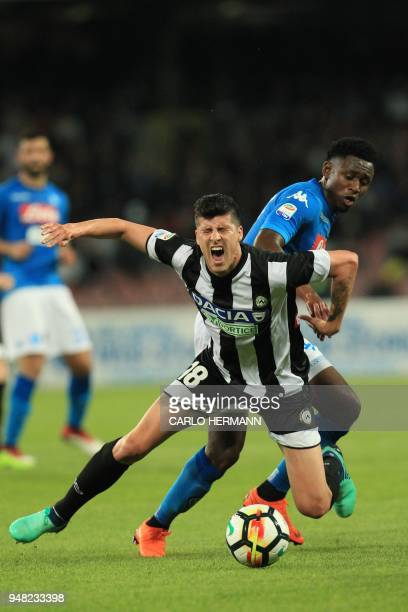 Napoli's Guinean midfielder Amadou Diawara fights for the ball with Udinese's Croatian forward Stipe Perica during the Italian Serie A football match...