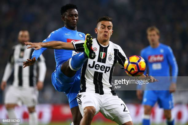 TOPSHOT Napoli's Guinean midfielder Amadou Diawara vies for the ball for the ball with Juventus' Argentinan forward Paulo Dybala during the Italian...