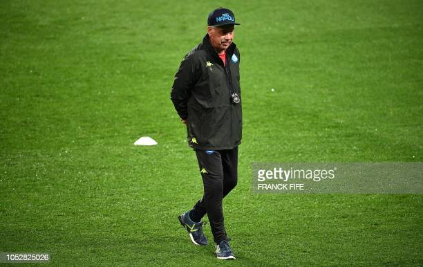Napoli's head coach Carlo Ancelotti walks on the pitch during a training session at the Parc des Princes stadium in Paris on October 23 2018 on the...