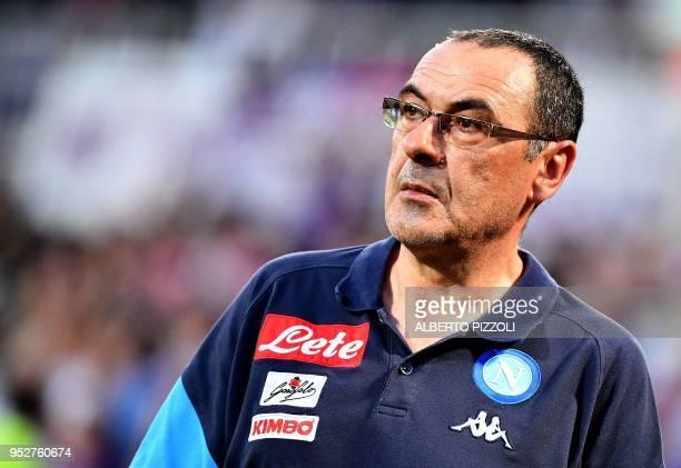 Napoli's head coach Maurizio Sarri leaves the field following the Italian Serie A football match Fiorentina vs Napoli on April 29 2018 at...