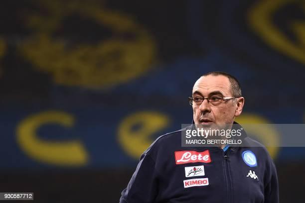 Napoli's head coach Maurizio Sarri looks on during the Italian Serie A football match Inter Milan vs Napoli on March 11 2018 at the San Siro stadium...