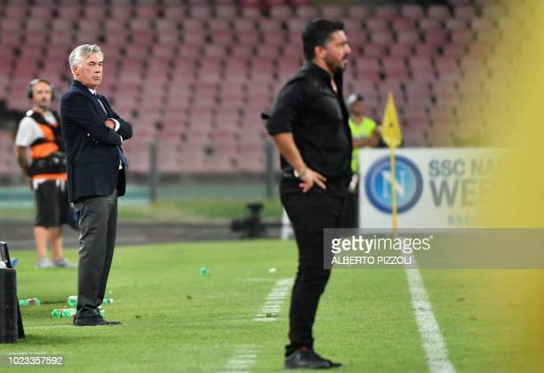 Napoli's Italian coach Carlo Ancelotti and AC Milan's Italian coach Gennaro Gattuso stand by the touchline during the Italian Serie A football match...