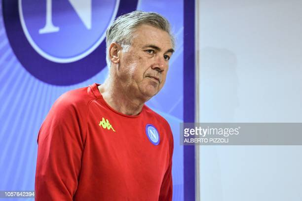 Napoli's Italian coach Carlo Ancelotti arrives for a press conference at the Castel Volturno training ground near Naples on November 5 2018 on the...