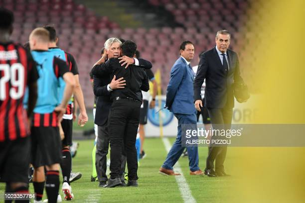 Napoli's Italian coach Carlo Ancelotti embraces AC Milan's Italian coach Gennaro Gattuso after the Italian Serie A football match Napoli vs AC Milan...