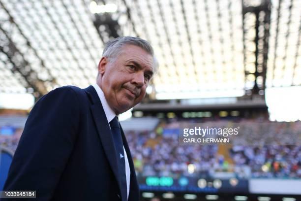 Napoli's Italian coach Carlo Ancelotti enters the pitch prior to the Italian Serie A football match Naples vs Fiorentina on September 15, 2018 at the...