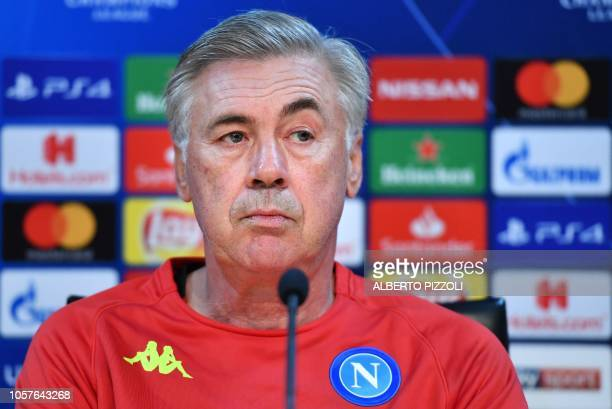 Napoli's Italian coach Carlo Ancelotti looks on during a press conference at the Castel Volturno training ground near Naples on November 5 2018 on...