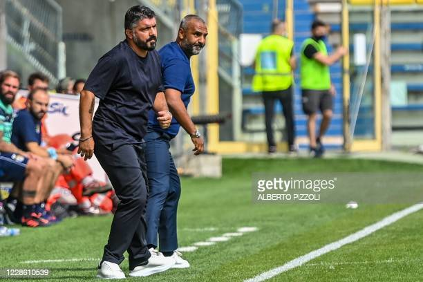 Napoli's Italian coach Gennaro Gattuso and Parma's Italian coach Fabio Liverani stand side by side along the touchline during the Italian Serie A...