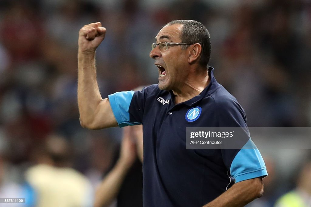 Napoli's Italian coach Mauricio Sarri reacts during the UEFA Champions League play-off football match between Nice and Napoli at the Allianz Riviera stadium in Nice, southeastern France, on August 22, 2017. /