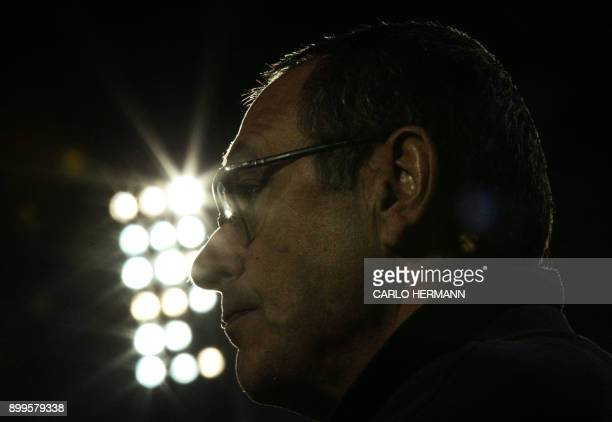 Napoli's Italian coach Maurizo Sarri looks on during the warmup of the Italian Serie A football match FC Crotone vs SSC Napoli on December 29 2017 at...