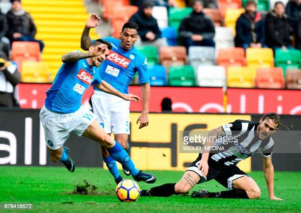 Napoli's Italian defender Christian Maggio and Napoli's Brazilian midfielder Allan fight for the ball with Udinese's Italian defender Gabriele Angela...