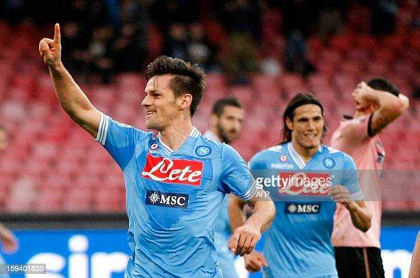 Napoli's Italian defender Christian Maggio celebrates after scoring a goal during an Italian Serie A football match between SSC Napoli and USC...