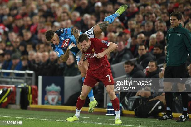 Napoli's Italian defender Giovanni Di Lorenzo clashes with Liverpool's English midfielder James Milner during the UEFA Champions league Group E...